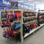 Double Sided Gondola Shelving With Feature End Bay Utilizing Display Hooks